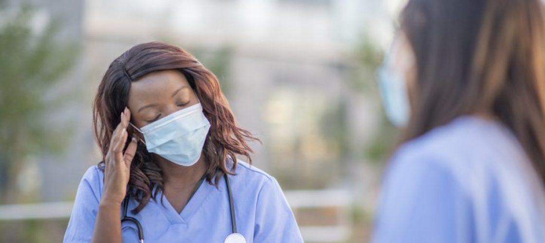Doctors wearing protective face masks meeting outside.